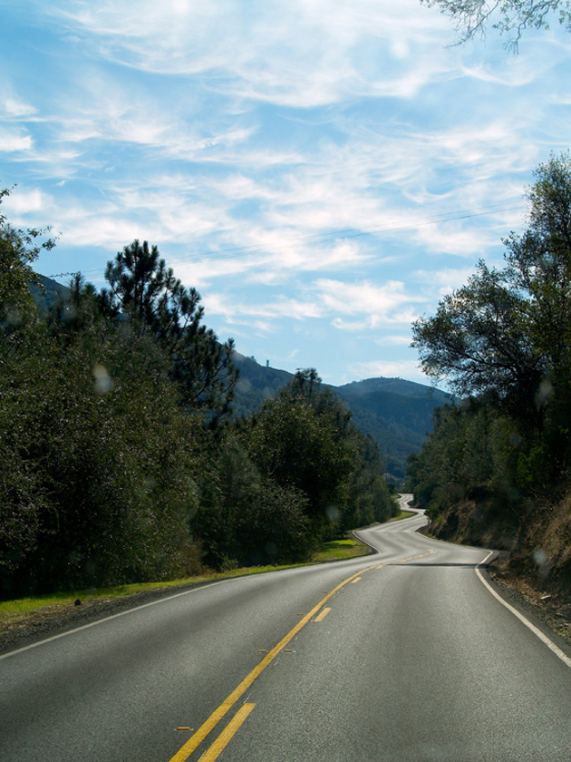 One of the last sinewy stretches of HWY 49 the team would encounter before taking HWY 120 toward Yosemite, as viewed through a bug-splattered E-350 windshield. / Photo by Don Stefanovich