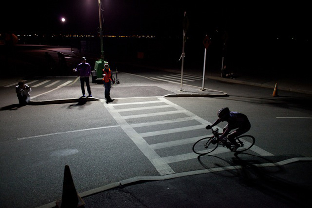 A lone rider looks for a line on one of the Red Hook Criterium's darker corners.r