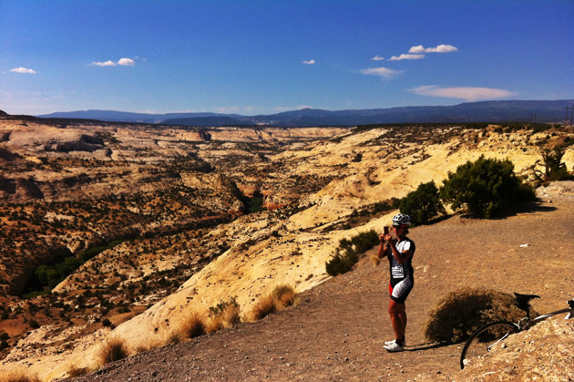 Specialized's inimitable Sophie Ballo takes a second away from hammering to snap a panorama just outside Escalante, Utah on Scenic Highway 12