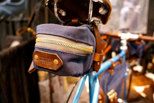 Tanner Goods technically made their NAHBS debt last year on Ira Ryan's Market Bike, but this year saw them with a dedicated cycling line featuring domestically sourced leather, waxed canvas, and panache.