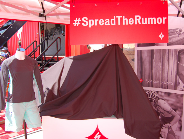 Specialized used a black cloth to tease its upcoming women's mountain bike. #Rumorhasitthebikeisa29er