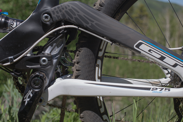 Here's a look at the PathLink. As the rear axle moves upward, the chainstays pull on the link - which houses the bottom bracket. As the link articulates on the pivot above the bottom bracket, the upper mount pushes the shock into its travel. Chain growth is minimized