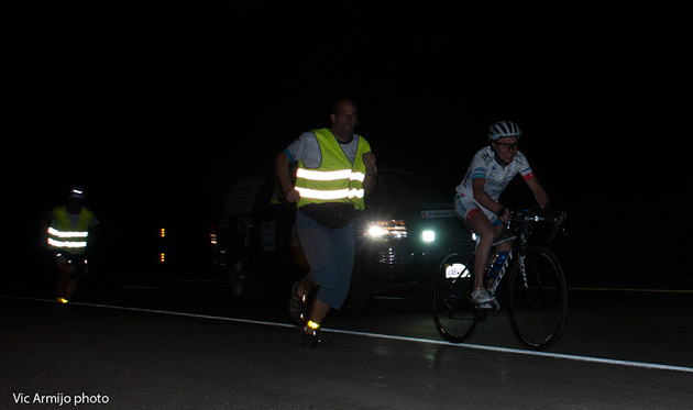 Reto Schoch receiving encouragement from a crew member on the long climb up Wolf Creek Pass last night. The 2012 winner is currently 5 hours and 35 minutes behind the leader and is just over an hour behind his last year's pace.