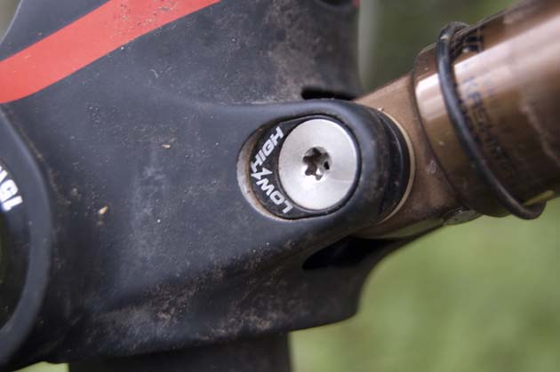 With a multi-tool and a spare five minutes, riders can swap this bolt to change the geometry of the Genius and Spark models. The low option drops the bottom bracket by 6 millimeters and slackens the head angle by a half a degree.