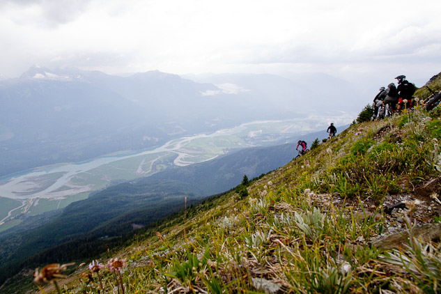 Dropping in to plenty of exposed side hill and epic views.