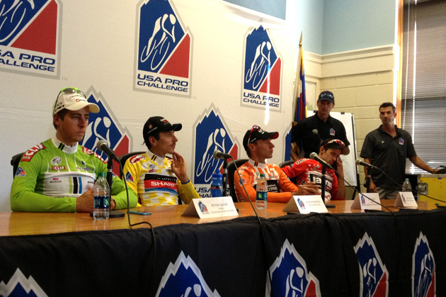Dazed and un-enthused. The heat of a long day is evident at the post-stage press conference.