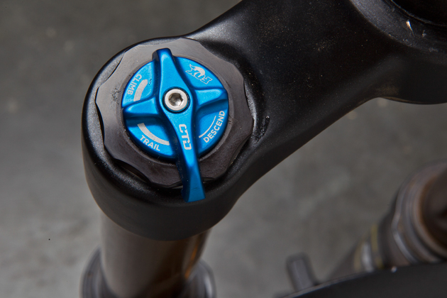 The adjustement knobs look the same, but there was much more compression adjustment provided in the fork we rode.