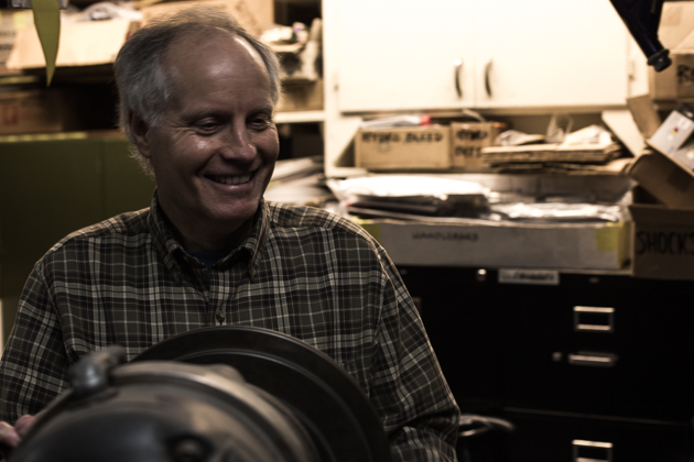 Joe Breeze in his basement shop in Fairfax, CA. He inherited many of the tools from his father, a machinist, including the Bridgeport mill he's standing over here. PHOTO: Ryan Palmer