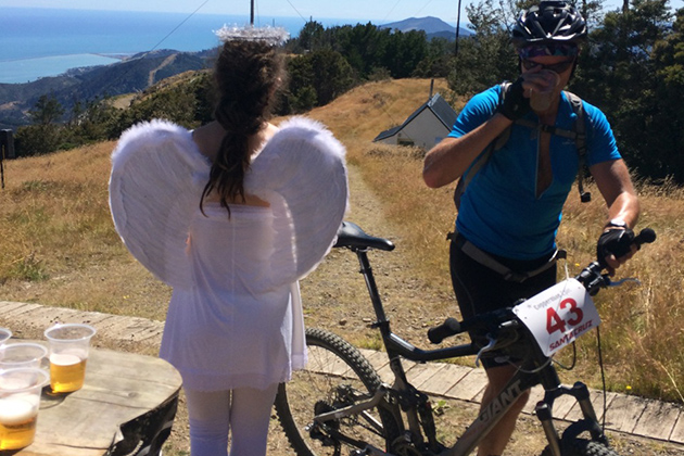Yes, that is beer in the cups at the top of the climb. No, those are not actually angels. Quite the opposite. PHOTO: Mike Ferrentino