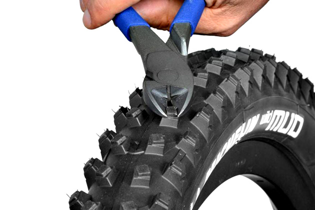 Those knobs are too tall and squirmy for you? Trimming the Michelin Mud is dead simple and will reduce the rolling resistance for drier conditions.
