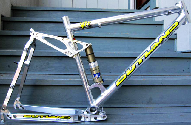 The elusive Outland VPP 5 had more than travel than most DH bikes of the time and accelerated like a rocket. It also had a way of falling apart over time...but the Outland idea eventually led to a staggering number of really great bikes from other manufacturers.