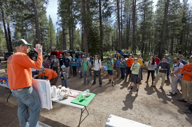 Ben Fish, TAMBA president, fills in local volunteers on the background of the Corral trail before sending them into the woods.
