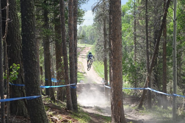 Hip out. Table down. The course had it all, including a road gap. | Photo courtesy of Angel Fire Bike Park