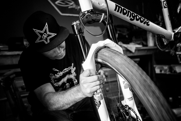Gregg Watts keeping his bike tuned up in his bike shed, before getting steezy.