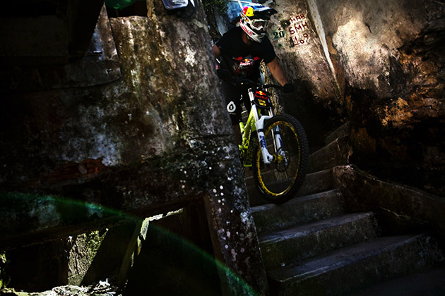 Stevie Smith rides through Dona Marta favela, during the Red Bull Desafio no Morro downhill challenge in Rio de Janeiro, Brazil.