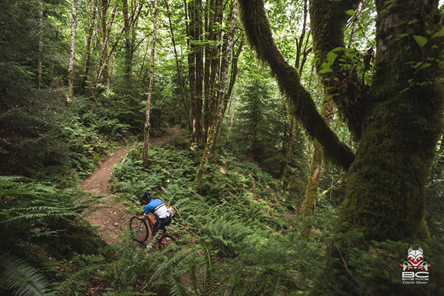 BC Ferries rider Barry Beck motors home through Crumpet woods.   Photo by Dave Silver