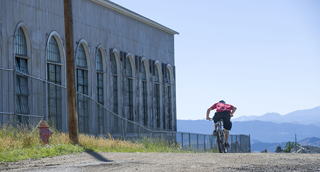 The course passed the motor house for the Con Mine, which sits a mile high with shafts a mile deep. The wind affected riders on the wide-open upper sections.
