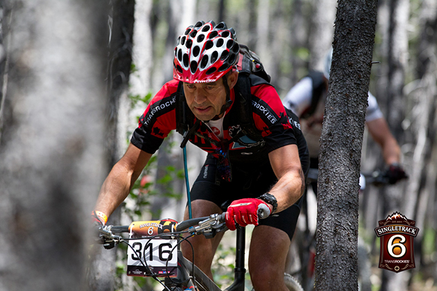 A rider in the open men 40+ category does his best to not get too up close and personal with some of the trees. With Handlebars getting wider every year, there are numerous bark scars throughout the trail network where riders got a little too friendly with the locals.