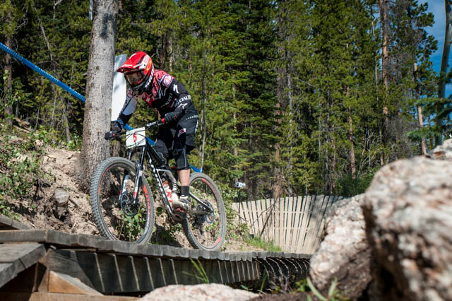 Enduro in a bike park means a fair bit of wooden features. Anneke Beerten's on the bridge to a second-place finish in Stage 1.
