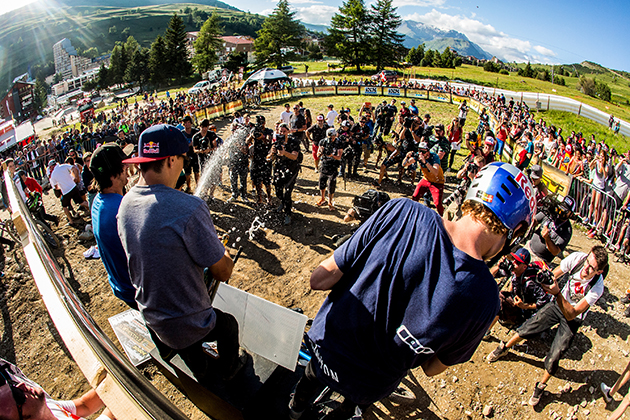 Anthony Messere, Thomas Genon and Sam Reynolds spray down the crowd. Photo: Sven Martin/Red Bull