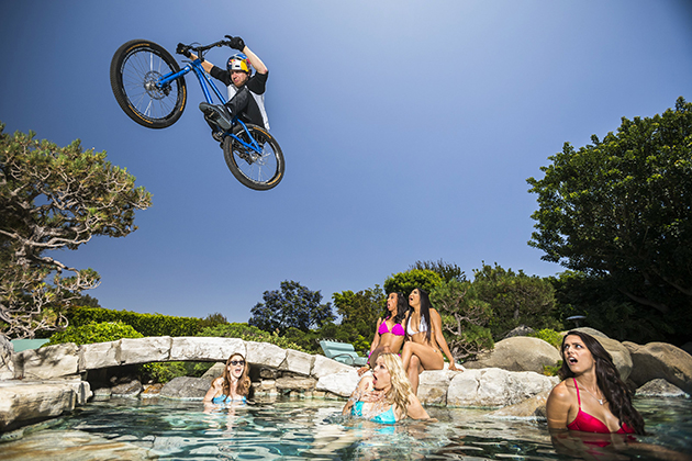 Danny MacAskill leaps over the pool at Hugh Hefner's Playboy Mansion. Photo by Garth Milan/Red Bull Content Pool.