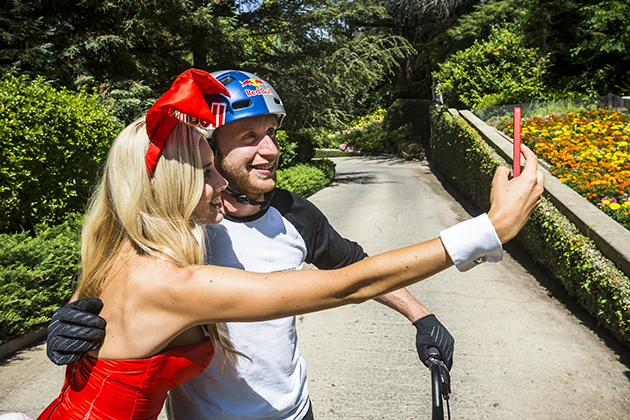 Danny MacAskill poses for a selfie with a Playboy Playmate at Hugh Hefner's Playboy Mansion. Photo by Garth Milan/Red Bull Content Pool.
