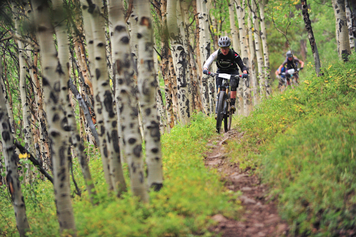 Heather Irmiger rides through an Aspen grove during stage 3 on Roaring Judy.