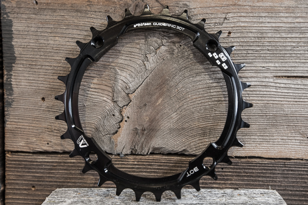 The e.thirteen Guidering M 104 fits standard mountain cranks and uses a dual-width tooth pattern to manage the single ring's chain retention. Available now in black, red or blue in even tooth numbers from 30 to 38.