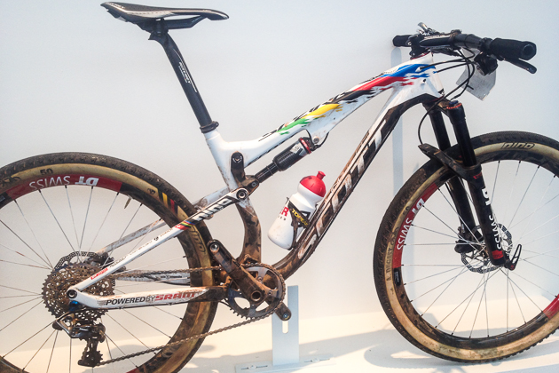 Scott Sports was showing the World Cup-winning bike of its star XC athlete, Nino Schurter. Nino won the last World Cup in Meribél, France, on his Spark and took second place overall for the 2014 World Cup title. Check out Nino's unique setup: seat far forward, stem slammed and bars flipped for an uber-aggressive position.