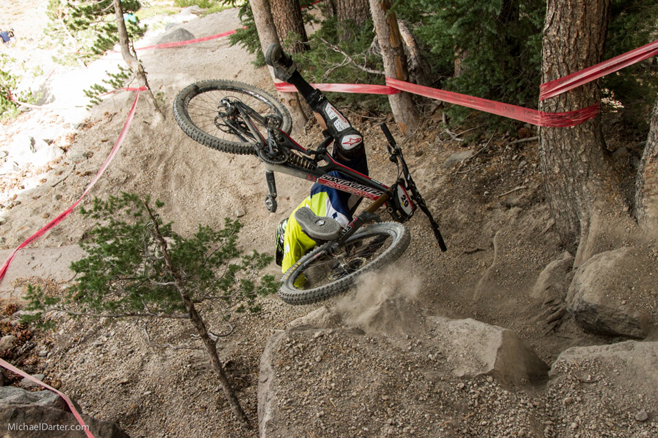 Chris Higgerson ejected out of a rock garden and somehow managed to avoid injury during the Pro GRT downhill race at Mammoth Mountain's 2014 Kamikaze Bike Games. Photo by Michael Darter.