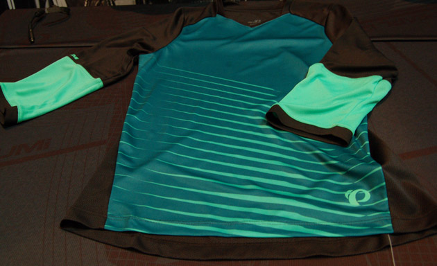 Pearl Izumi hired a female designer and a color specialist to rework its line for 2015. The result is a deep selection of about 22 pieces focused on all-mountain and XC riding including this Launch three-quarter-sleeve jersey.