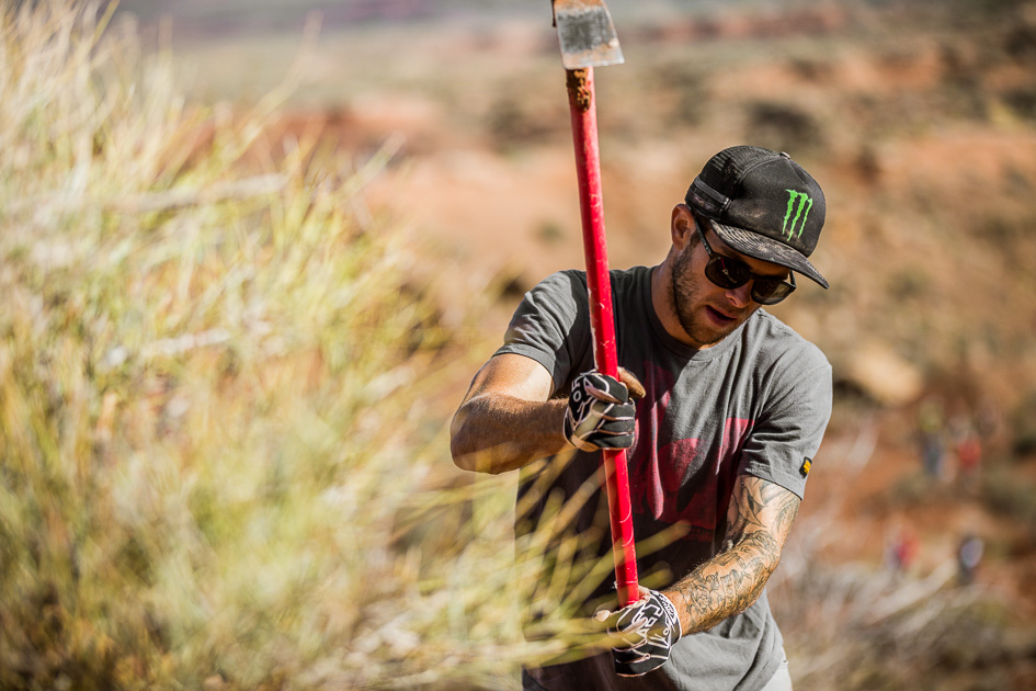 The world's best big-mountain riders were getting their hands dirty this morning in an effort to repair their rained-drenched lines, and one-time Rampage winner Cam Zink was no exception.