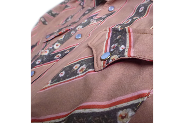The Western shirts feature pearl snaps and cuffed sleeves.