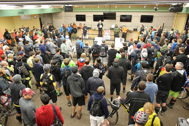 During the riders meeting, race organizers explained the changes that needed to be made to the course due to weather. Photo by Bogdan Marian