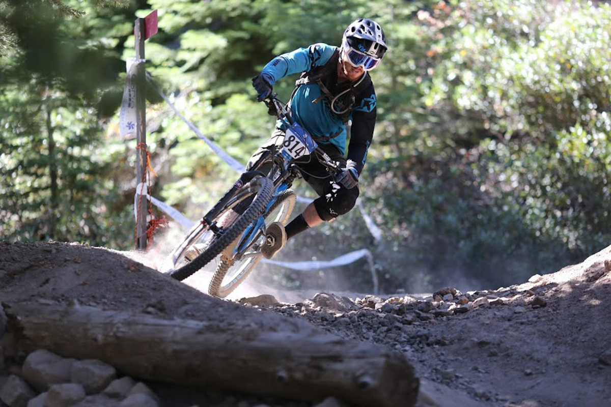 """Tom Doran navigates a tight switchback on the 2014 Northstar Livewire Classic Enduro course. Tom says, """"I really like the challenge and diversity that the CES events bring out. 2015 is sure to provide killer tracks, great venues and a lot of smiling faces."""" (Bogdan Marian)"""