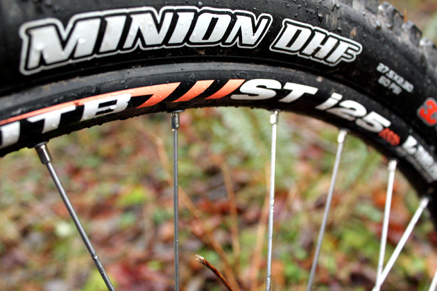"""A lot of companies spec their bikes with the lightest tires they can in an attempt to give the bike a """"snappy"""" feel. Kona bucks that trend (thank God) and gives the Process 153 some seriously meaty tires and wheels. It's hard to do better (when you're a hard-charging rider on a budget) than the Maxxis Minion/WTB i25 wheel and tire combo."""