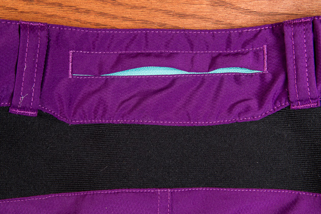 A third zippered pocket on the back waist provides one more place to stash cash or keys, and the stretch fabric below prevents bunching and the dreaded back gap.