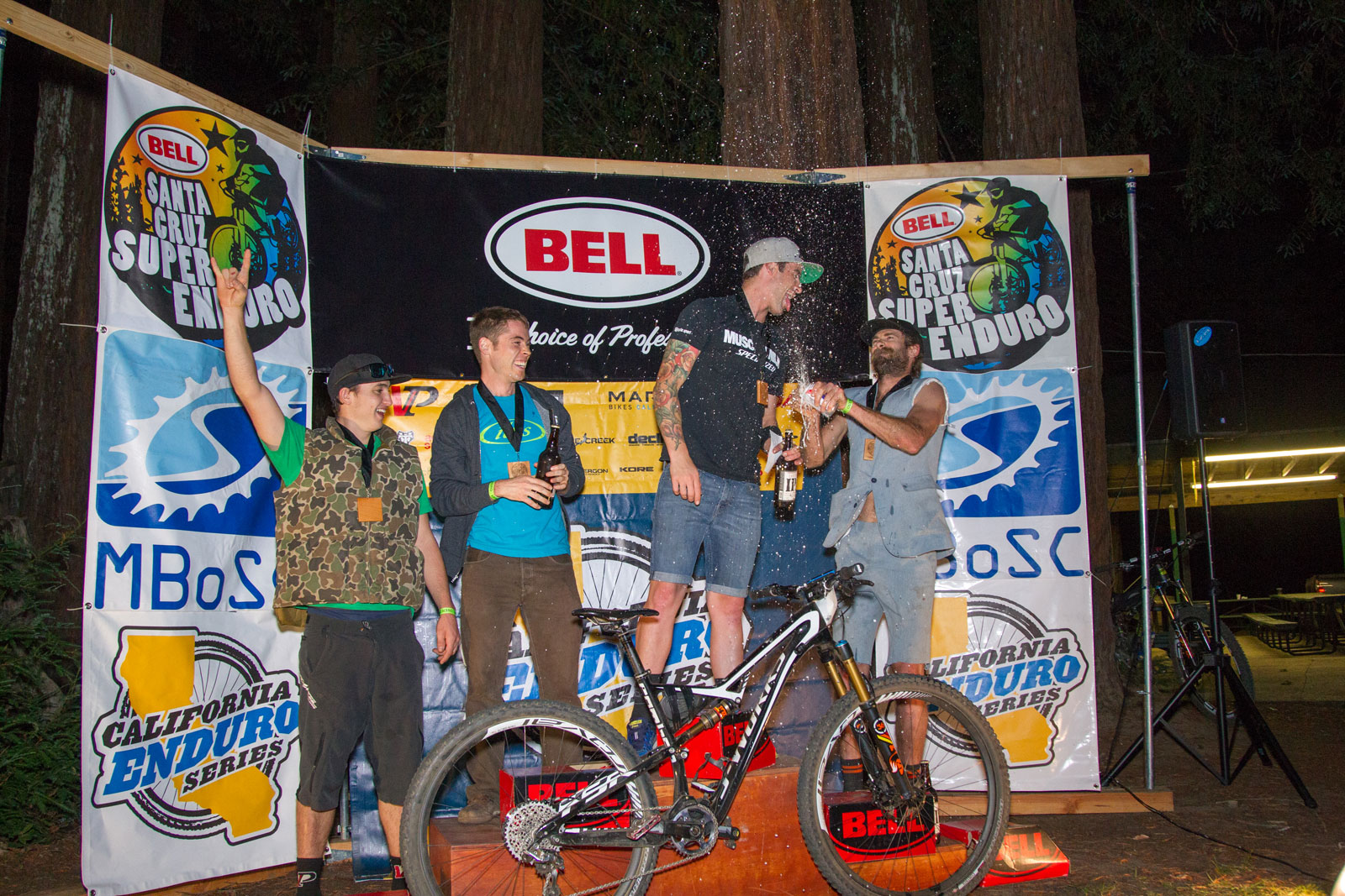 Enduro camaraderie on the 2014 series Pro Men podium. 1st - John Hauer, 2nd Jeff Kendall-Weed, 3rd - Scott Chapin, 4th Marco Osborne, 5th Aaron Bradford (not pictured) (Bogdan Marian).