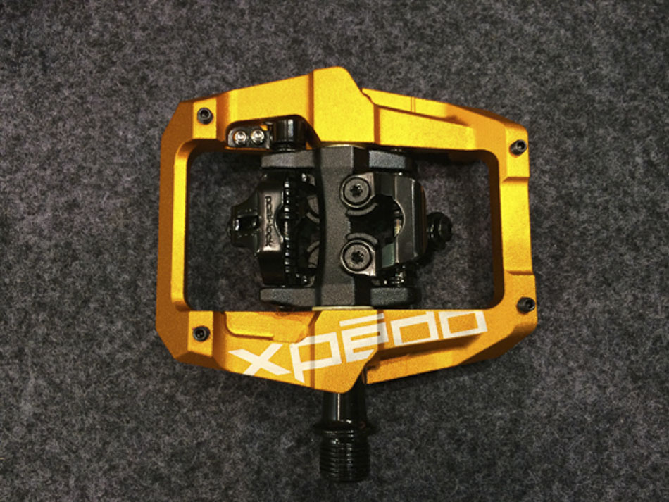 Xpedo is introducing a new clipless pedal with a forged aluminum platform cage. The pedal, which is SPD-compatible, is expected to cost $139 a pair.