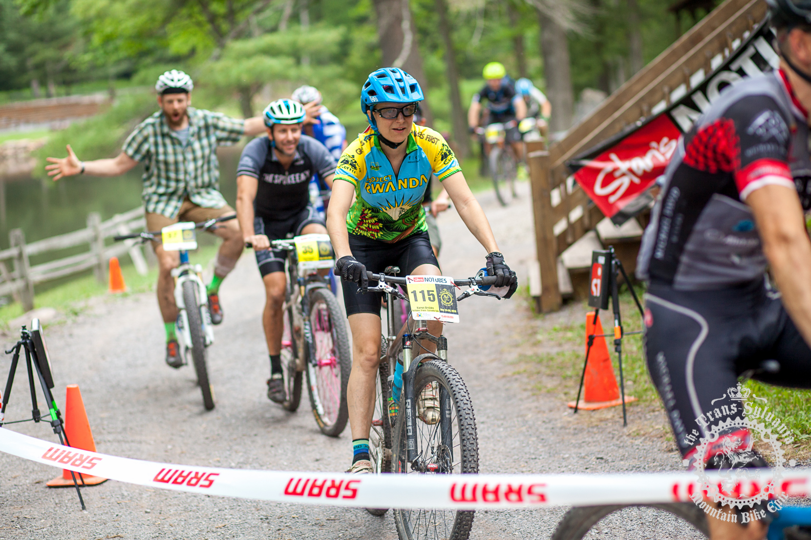 Karen Brooks (NoTubes Trans-Sylvania Epic) crosses the finish with the other singlespeeders.