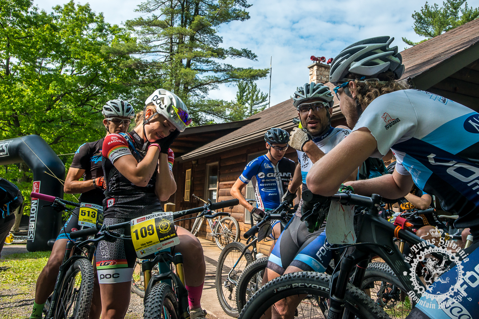 Riders chat at the start.