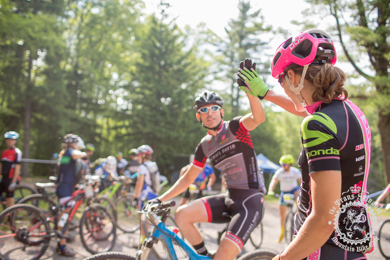 Mical Dyck (Stan's NoTubes Elite Women's Team) congratulates other racers at the finish.