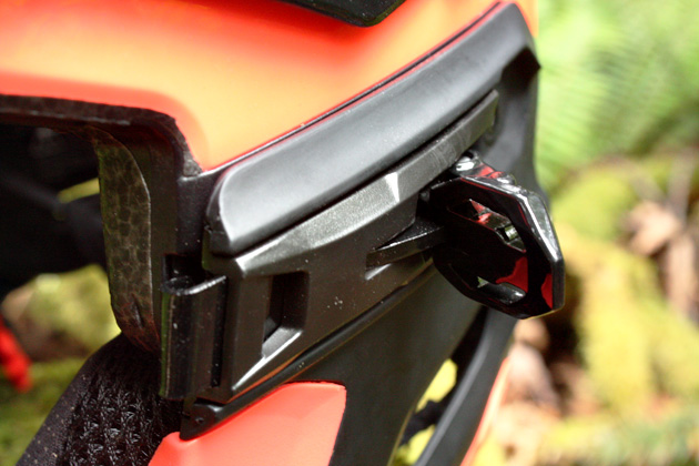 The Bell Super 2R sports three ski-boot style buckles that fix the chin-bar in place: two on the sides and one at the back of the helmet.