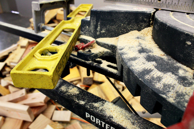 Under construction: many of the display racks are being constructed from local logs that are being milled right here in the shop by Kona employees. Here, someone gets crafty with the miter saw.