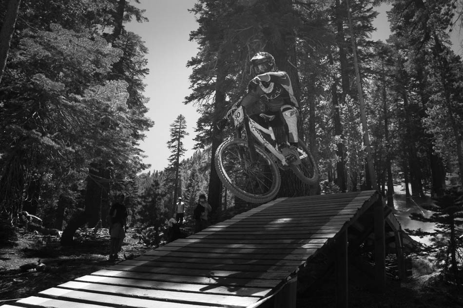 Bryan Pagel shows how to stay low. This bridge is after one of the steepest and fastest sections, and riders come into this feature with a whole lot of speed.