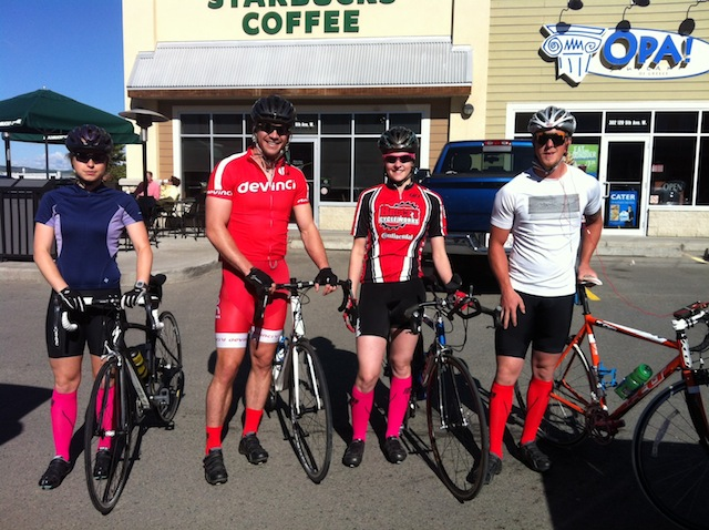 One day you show up to a group ride and realize you and all your friends are dressed like this. This could happen to you too. Consider yourself warned. Note the guy, second from the left--he's rocking calf-high socks, but it's only a matter of time before he joins his friends with knee-high versions. Poor bastard.