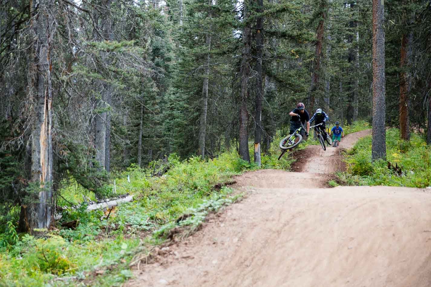 Logan James and Dennis Martin shredding one of the jump lines.