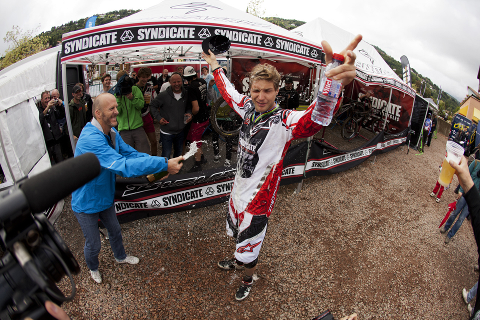 Greg Minnaar gets the standard Santa Cruz Syndicate victory soaking from the bossman himself Rob Roskopp.