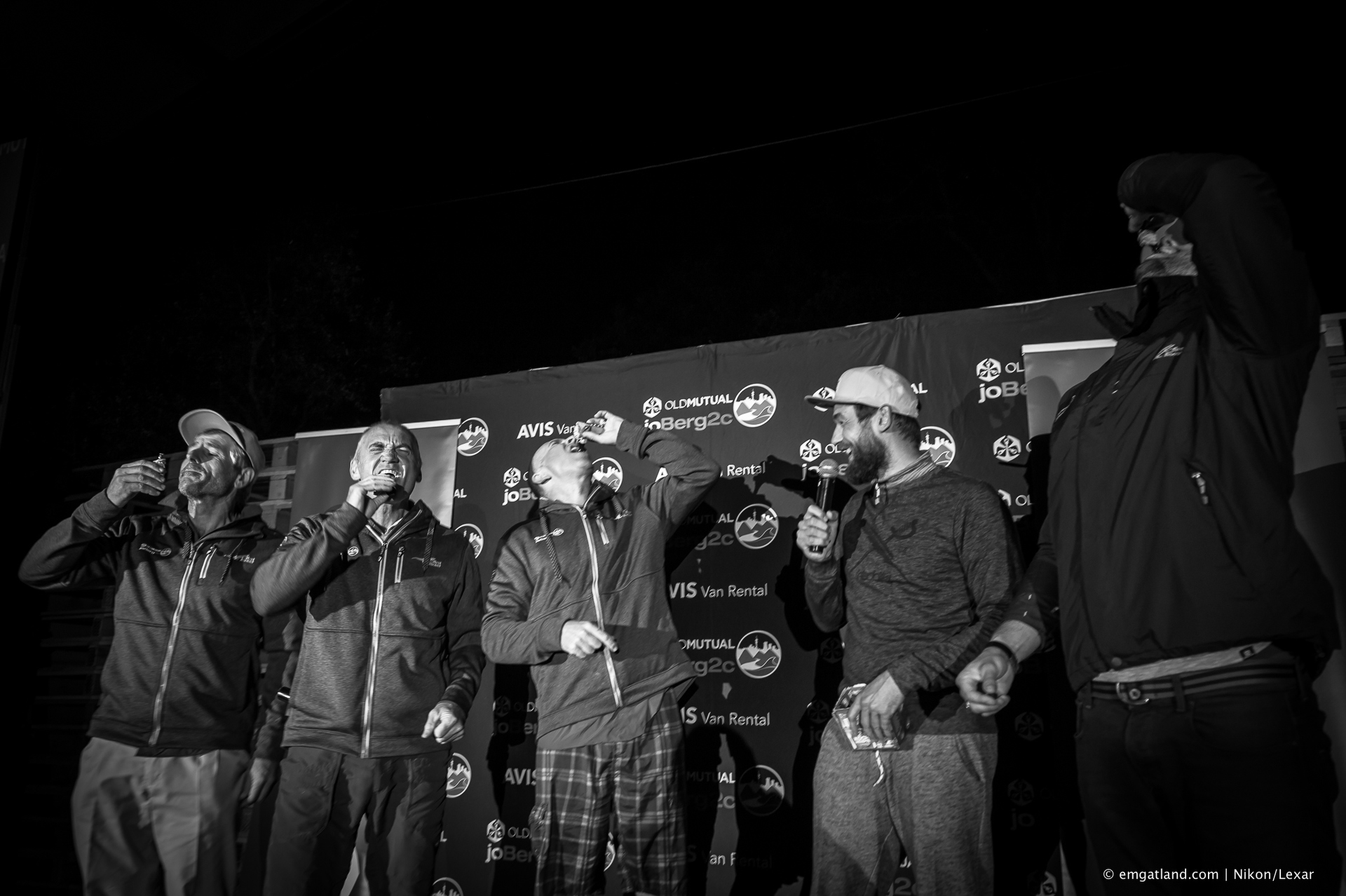 Gary Green, Glen Haw and Craig Wapnick share an underberg shooter on stage during the Joberg2c.