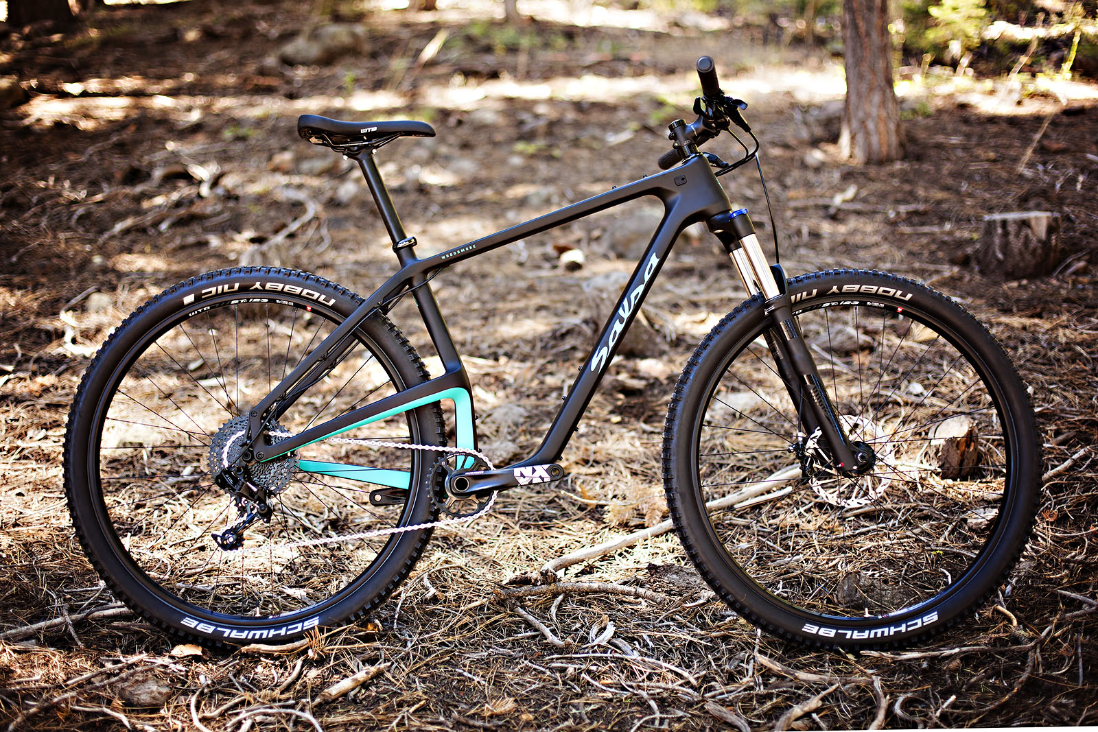 Only offered with traditional 29er hoops, the $2000 NX1 kit sports a primarily SRAM NX drivetrain, Level brakes and a Salsa cockpit.